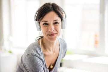 Portrait of a woman, wearing headphones