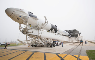 Handout photo of a SpaceX Falcon 9 rocket with the company's Crew Dragon spacecraft onboard is seen as it is rolled out of the horizontal integration facility in Cape Canaveral, Florida