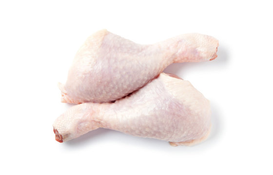 Raw chicken leg, thigh isolated on white background. Top view.