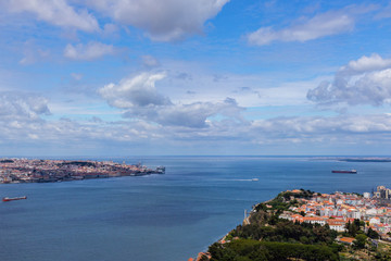 aerial view of Lisbon city from opposite side of the river Tagus, Portugal