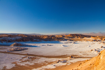 Wide panorama landscape of Moon Valley in Atacama desert, Andes mountain chain in the background, Chile, South America