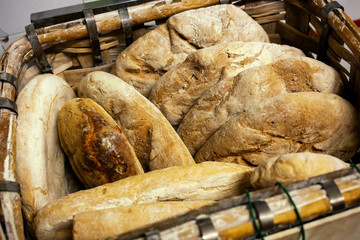 Basket of baked bread with wood oven