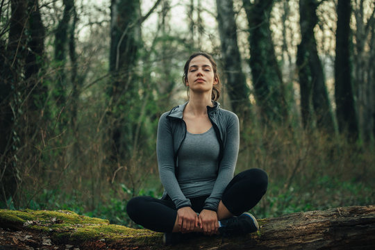 Young beautiful woman exercise in the forest