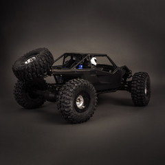 Radio-controlled car models: a little black buggy on a dark gray background.