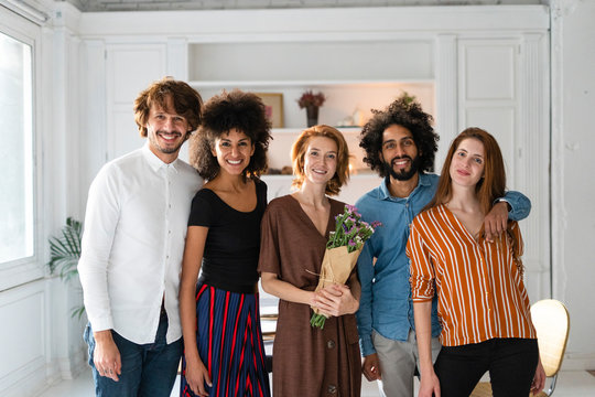 Group picture of friends, celebrating the birthday of a young woman