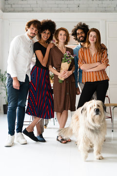 Group picture with a dog, of friends, celebrating the birthday of a young woman
