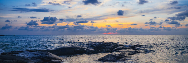 Nang Thong Beach at sunset, Khao Lak, Thailand. Tropical colorful dramatic sunset with cloudy sky . Evening calm on the Gulf of Thailand. Bright afterglow.