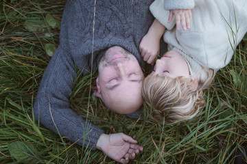 Father with son lying in meadow