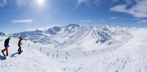 France, French Alps, Les Menuires, Trois Vallees, Panoramiv view with snowboarders