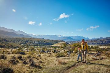 Chile, Cerro Castillo, mother with son on a hiking trip