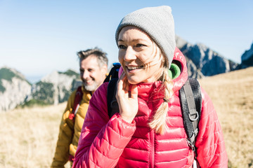 Austria, Tyrol, smiling couple hiking in the mountains