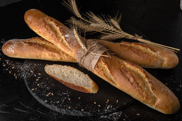 Freshly baked delicious baguette bread Homebaked. Useful, tasty, nutritious.