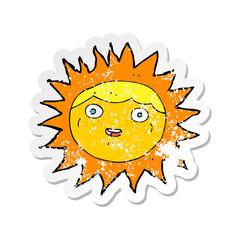 retro distressed sticker of a sun cartoon character