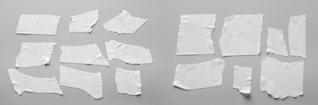 Set of white tapes on gray background. Torn horizontal and different size black sticky tape, adhesive pieces.