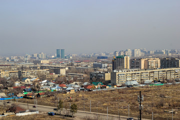 Cityscape of the city of Almaty in daytime in March