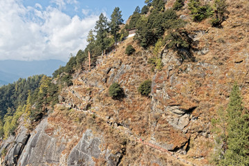 Bhutan, Asia – Buddhist monastery on a steep rock.