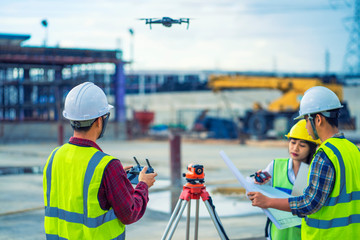 civil engineering flying drone over construction site survey for land and building project. Wall mural
