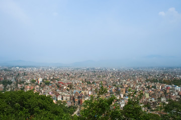 Panorama of the city among the mountains.