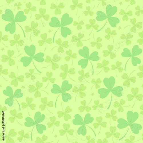 c6244563 Saint Patrick's day seamless background in light green with cloverleafs and  stars. Shamrock irish background. For web, textile, wrapping paper,  wallpaper, ...