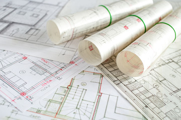 Architect workplace. Architectural project, blueprints, blueprint rolls on wooden desk table. Construction background. Engineering tools. Copy space