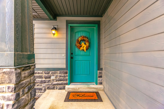 Entryway with wreath and doormat on the front door