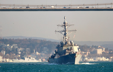 The U.S. Navy Arleigh Burke-class guided-missile destroyer USS Donald Cook (DDG 75), with the Russian Navy's frigate Admiral Essen in the background, sets sail in the Bosphorus, on its way to the Mediterranean Sea, in Istanbul