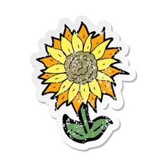 retro distressed sticker of a cartoon flower