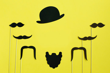Happy Father's Day. image of a man on paper. Beard and mustache on yellow background. Concept of prostate cancer