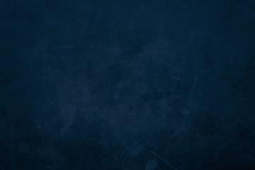 Dark blue grungy canvas background or texture
