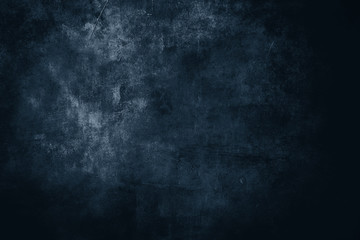 dark blue distressed wall, grungy background or texture