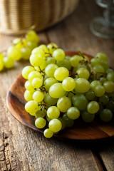 Ripe white grape on wooden desk