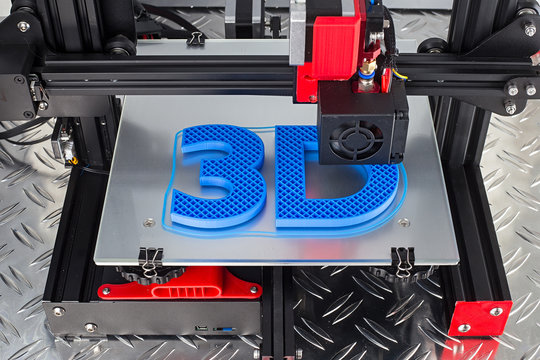 Red black 3D printer printing blue logo symbol on metal diamond plate future technology modern concept