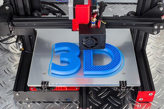 Red black 3D printer printing blue logo symbol on metal diamond plate future technology modern concept