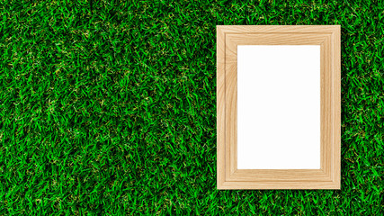Classic wooden photo frame on green lawn.