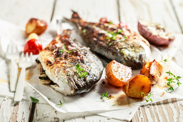 Potatoes and sea bream with cherry tomatoes