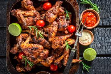 Top view of grilled chicken leg with rosemary and spices