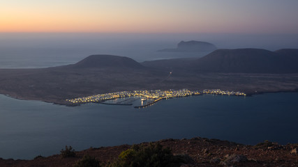 Panoramic view from the Mirador del Rio in Lanzarote during sunset with the island of La Graciosa