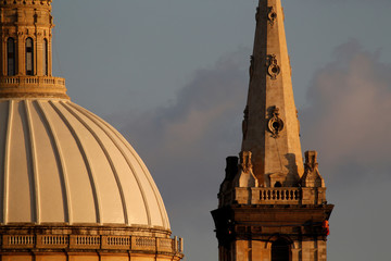Specialist workers abseil from the church spire as strapping and a debris-containing nets are installed during urgent restoration works on the tower of St Paul's Anglican Pro-Cathedral in Valletta