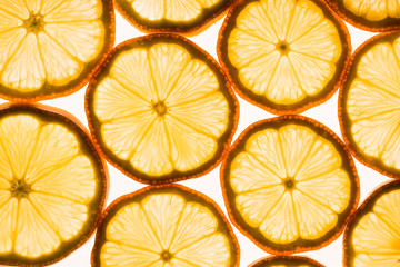Transparent lemon slices on a white background