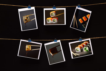 photo of sushi with fish attached with on linen rope on a black background, concept japanese food industry, snack bar decor