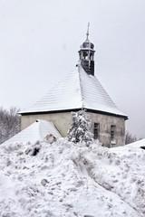 Little chapel over the large snow drift