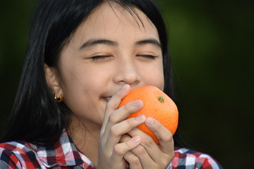 Youthful Asian Adolescent And Happiness With Fruit