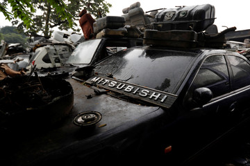 A sign of Mitsubishi is seen at a car junkyard on the outskirts of Jakarta