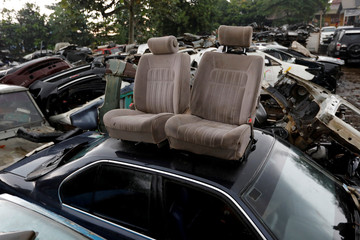 Car seats are seen at a car junkyard on the outskirts of Jakarta
