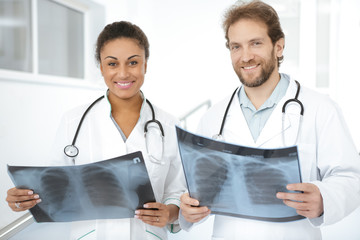 Group of diverse doctors discussing x-ray of the patient