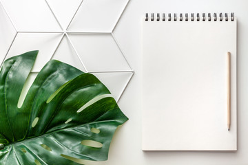 White empty notebook with space for your text on a geometric pattern. Copy space, mockup....
