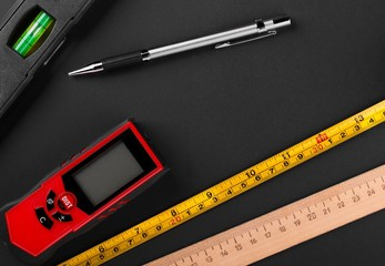 Measuring tools and automatic pencil on matte dark background