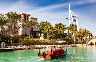 DUBAI, UAE - FEBRUARY, 2018: View on Burj Al Arab, the world only seven stars hotel seen from Madinat Jumeirah, a luxury resort which include hotels and souk spreding across over 40 hectars