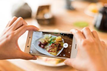 taking photo at breakfast