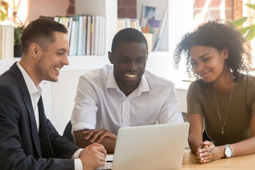 Insurance broker consulting african couple showing online presentation on laptop